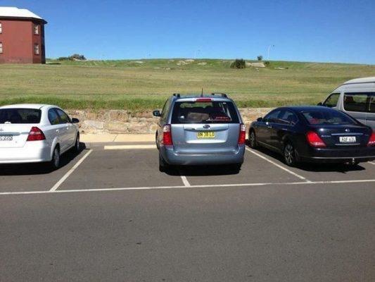 parkir mobil di luar ruangan  Begini Cara Mencuci Mobil Putih Agar Tidak Menguning parkir mobil di luar ruangan 533x400
